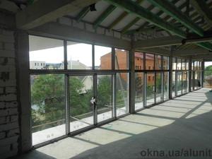 Розсувні двері з алюмінієвого теплого профілю в м. Ужгород (ресторан) — Компания Алунит