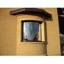 Цилиндрическое окна в частном доме